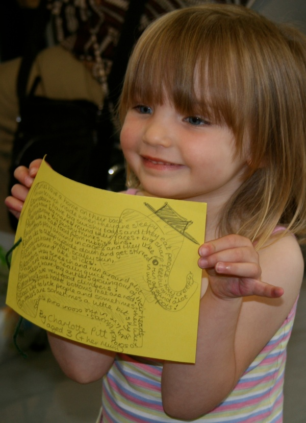 Three year old proudly holding the shape poem she dictated to her mum. The Poetry Immersion Kit is available when I visit schools. Immerse your class in words and images and sensory input that will inspire the best writing! I also give workshops and readings, lizpoet @ gmail.com